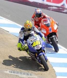 Valentino Rossi  on the Corkscrew as Casey Stoner of Australia  Moto GP US Grand Prix   Laguna Seca  Monterey, California, USA, 20 July 2008.