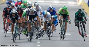 Garmin-Sharp team rider Talansky of the U.S. crashes as Omega Pharma-Quick Step team rider Matteo Trentin of Italy sprints to win the 234.5 km seventh stage of the Tour de France cycling race from Epernay to Nancy